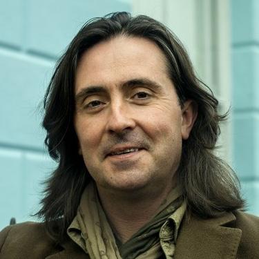 Neil Oliver Scottish Coast television presenter archaeologist conservationist author speaker at Great British Speakers